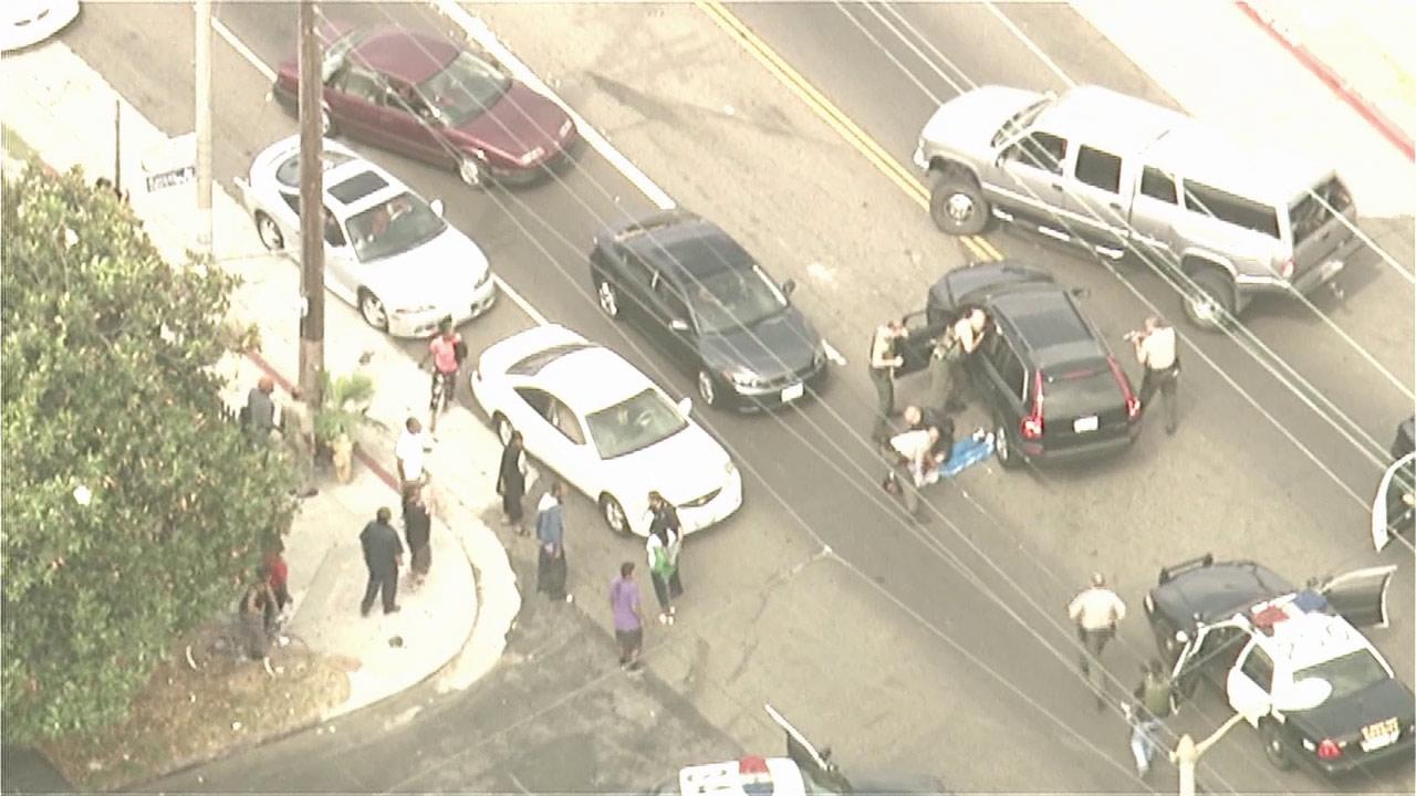 Deputies take bank robbery suspects into custody in South Los Angeles at the end of a wild pursuit on Wednesday, Sept. 12, 2012.