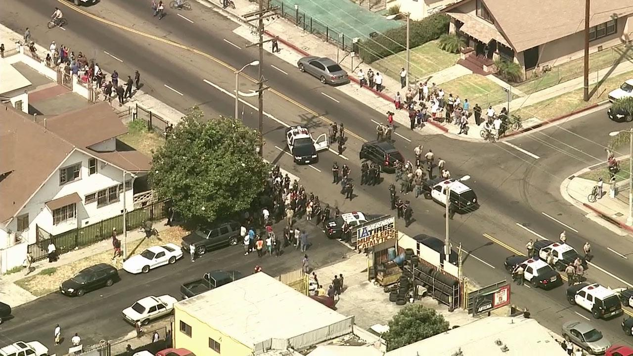Additional police units responded to help with crowd control, as deputies took two suspects into custody in South L.A. following a wild chase on Wednesday, Sept. 12, 2012.