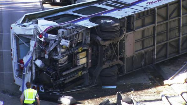 Bus veers off overpass, lands near 110 Fwy