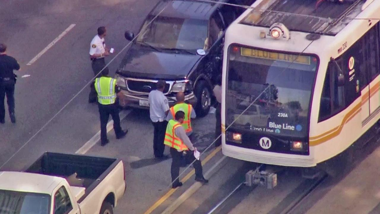 Four people were injured when a car crashed into a Metro Blue Line train in downtown Los Angeles on Friday, Sept. 14, 2012.