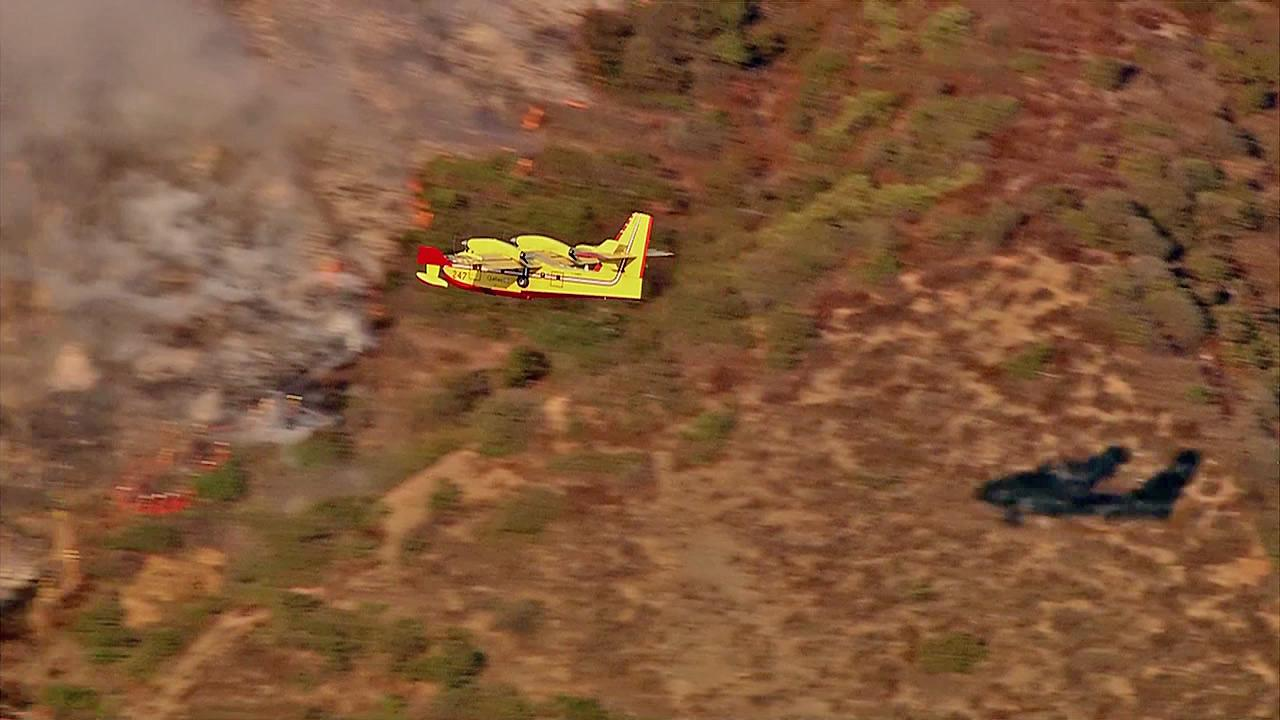 A Super Scooper is seen preparing for a water drop on a fire in the Sepulveda Pass near the 405 Freeway at Getty Center Drive on Friday, September 14, 2012.