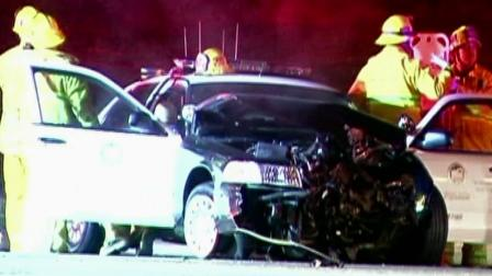 Firefighters surround an LAPD squad car that crashed in Los Feliz on Tuesday, Sept. 18, 2012.