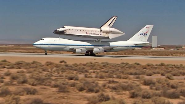 The space shuttle Endeavour is shown taxiing aboard a modified Boeing 747 after landing at Edwards Air Force Base on Thursday, Sept. 20, 2012.