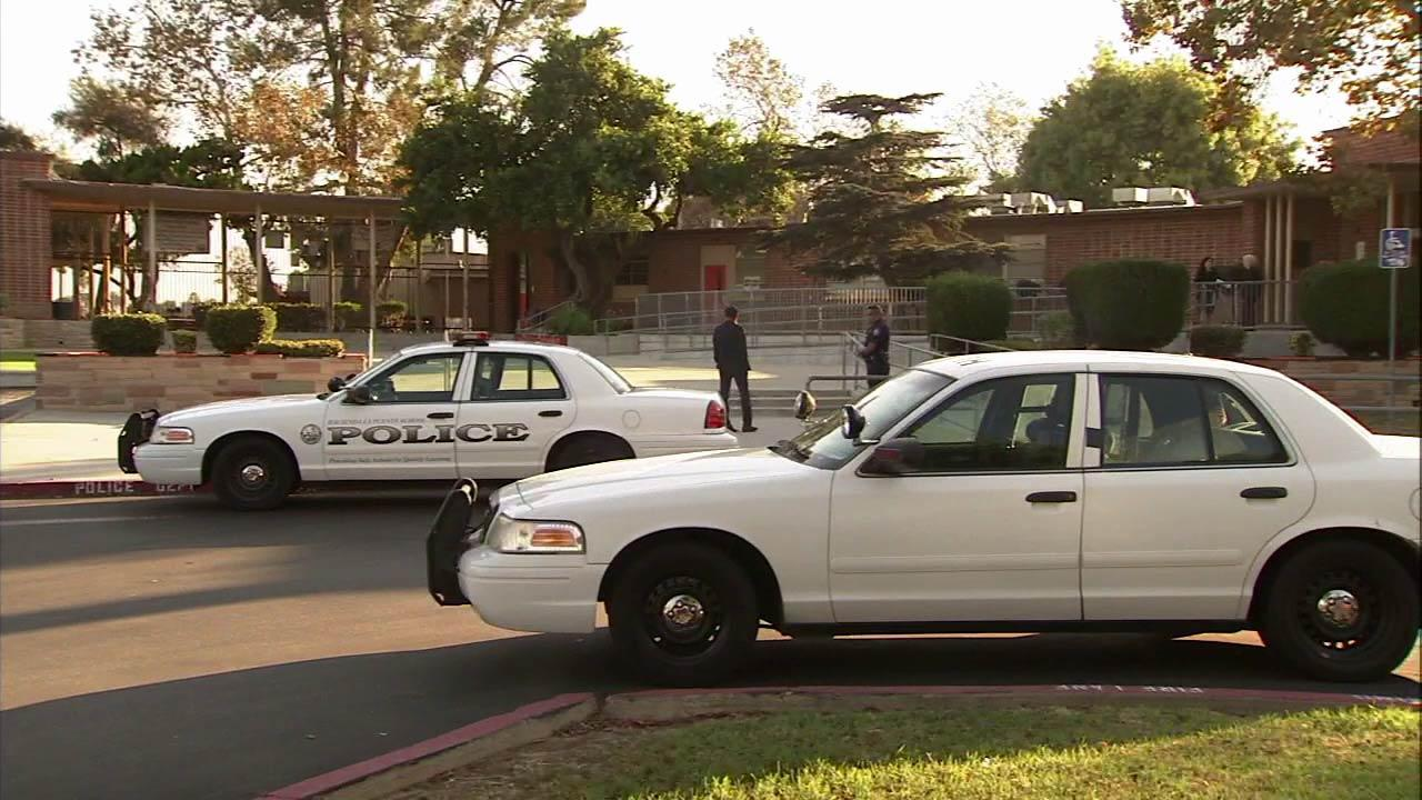 Police are seen outside La Puente High School on Monday, Sept. 24, 2012.