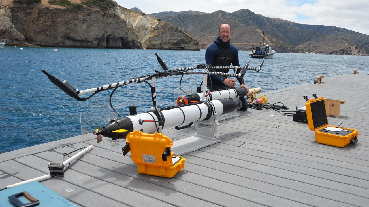 Dr. Chris Lowe, a marine biologist at Cal State Long Beach, is seen with two of his shark-tracking robots off Catalina Island in July 2012.Courtesy of Dr. Gwen Goodmanlowe