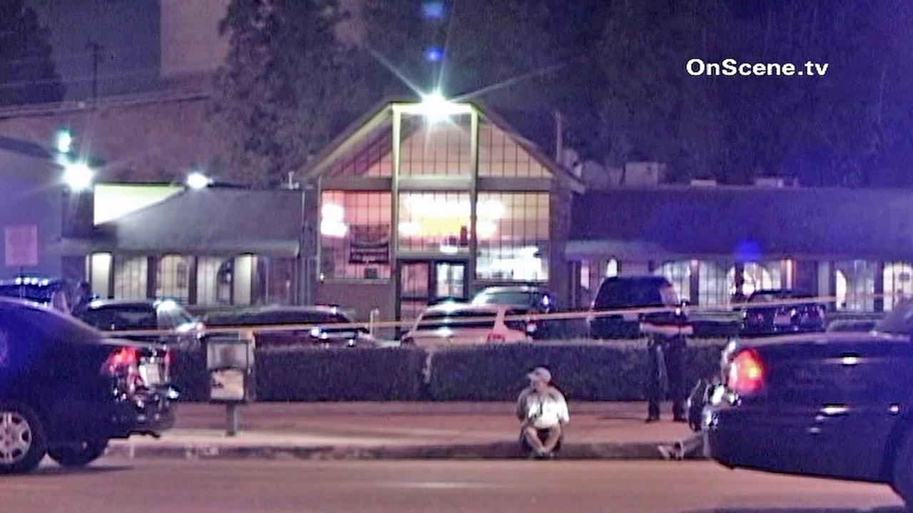 Police are seen outside a Shakeys in Monterey Park where a man was shot and killed Saturday, Oct. 6, 2012.