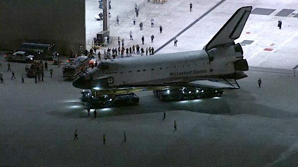 Space shuttle Endeavour leaves a hangar at Los Angeles International Airport on Thursday, Oct. 11, 2012.