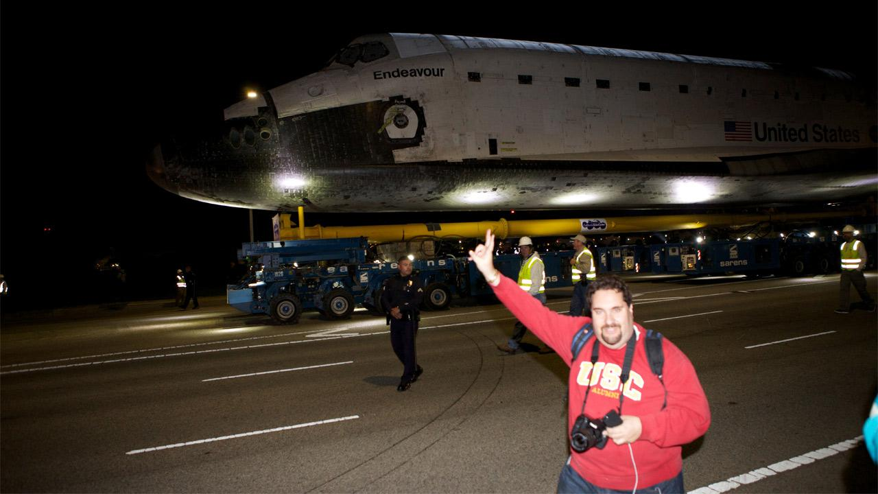 ABC7 viewer Victor Orly stands in front of space shuttle Endeavour along Westchester Parkway on Friday, Oct. 12, 2012.ABC7 viewer Victor Orly