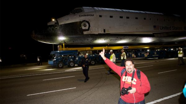 ABC7 viewer Victor Orly stands in front of space shuttle Endeavour along Westchester Parkway on Friday, Oct. 12, 2012.
