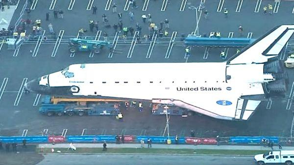 Space shuttle Endeavour makes a stop at a private parking lot before co