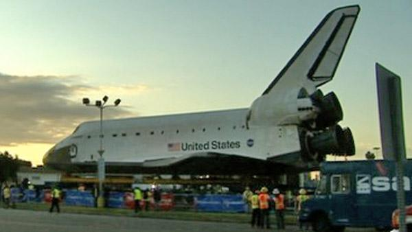 Space shuttle Endeavour makes a stop at a private parking lot before continuing on its 12-mile journey to the California Science Ce