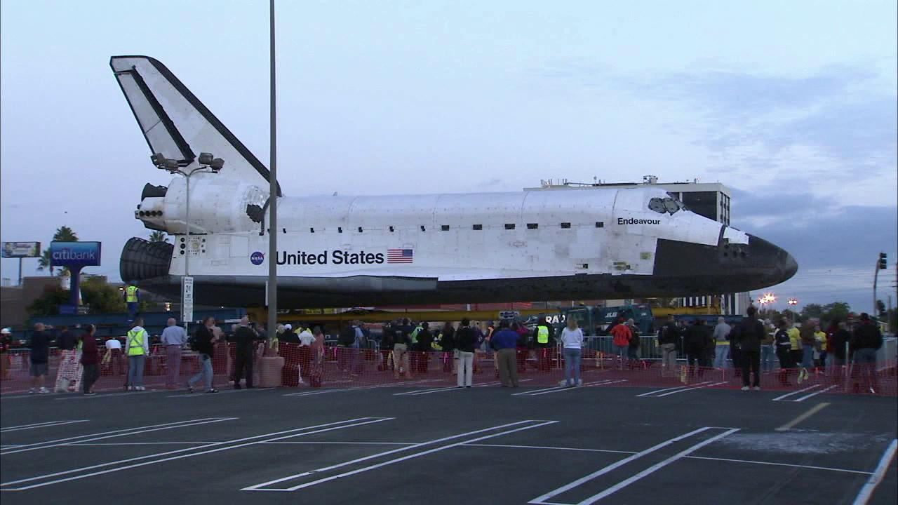 Space shuttle Endeavour makes a stop at a private parking lot before continuing on its 12-mile journey to the California Science Center on Friday, Oct. 12, 2012.