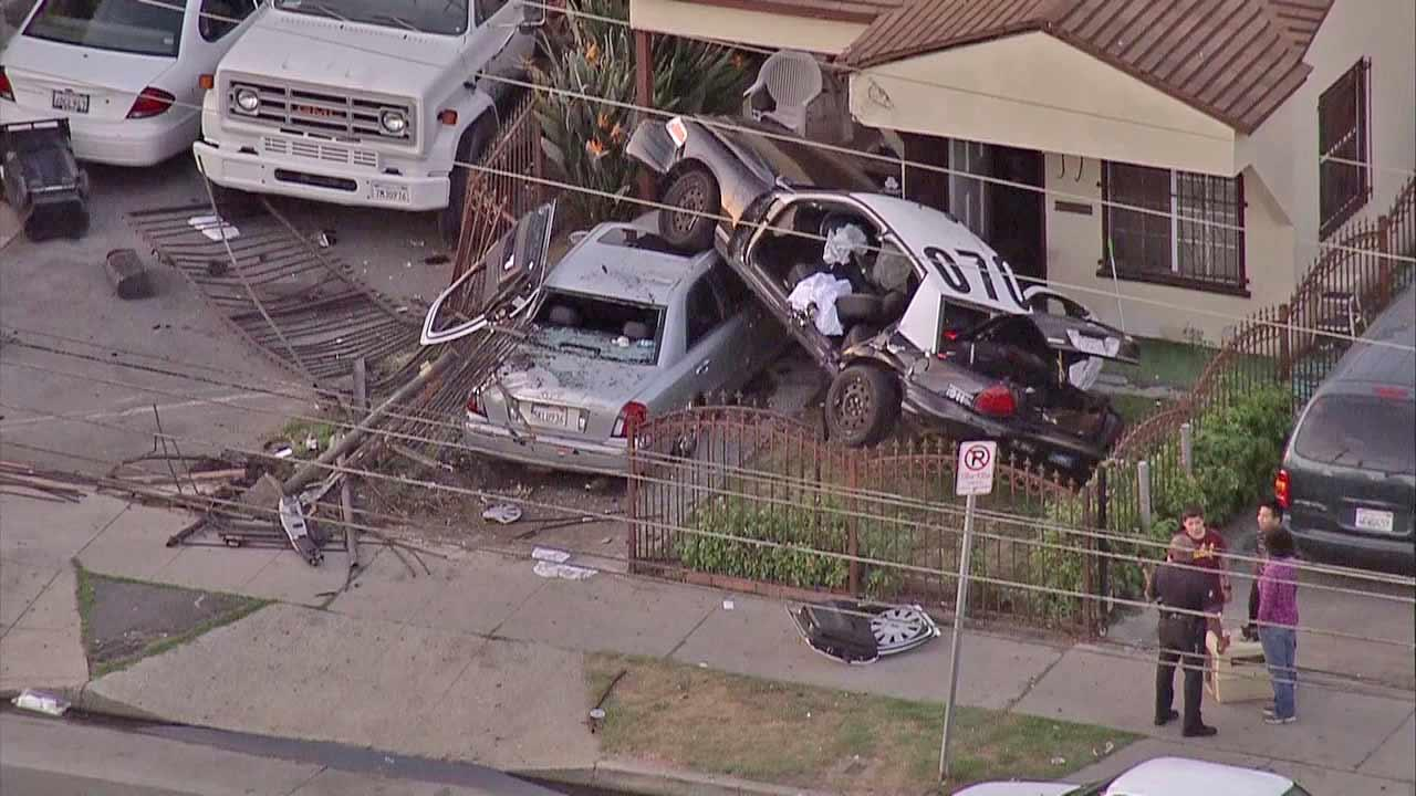 Three Los Angeles Police Department officers were injured Friday afternoon when their car crashed into a front yard in South Los Angeles on October 12, 2012.