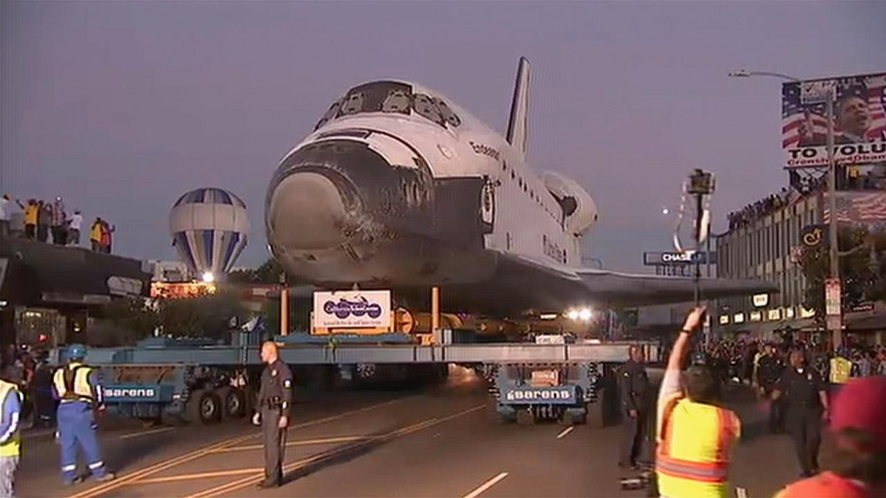 Space Shuttle Endeavour moves through the streets on its way to the California Science Center on Saturday, Oct. 13, 2012.