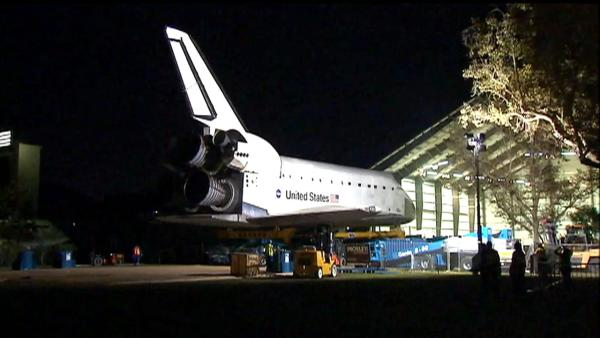The space shuttle Endeavour moves slowly into its hangar at the California Science Center on Sunday, Oct. 14, 2012.