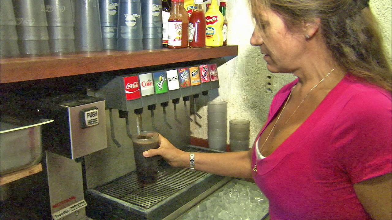 Erica Hadjis, whose family has owned El Sombrero restaurant in El Monte for 46 years, is seen dispensing a soft drink in this undated file photo.