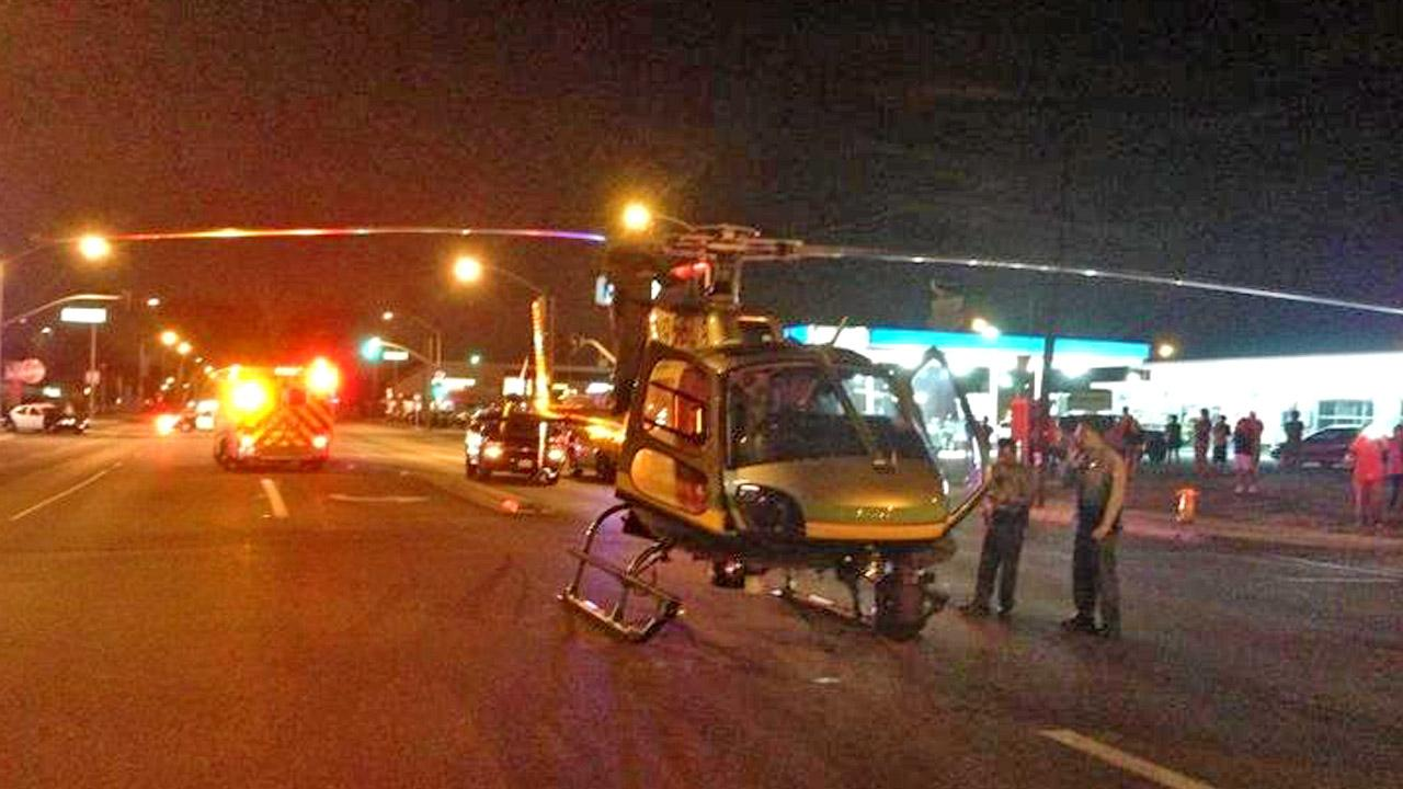 A Los Angeles County Sheriffs Department helicopter made an emergency landing in a residential neighborhood in Lakewood on Sunday, Oct. 21, 2012.