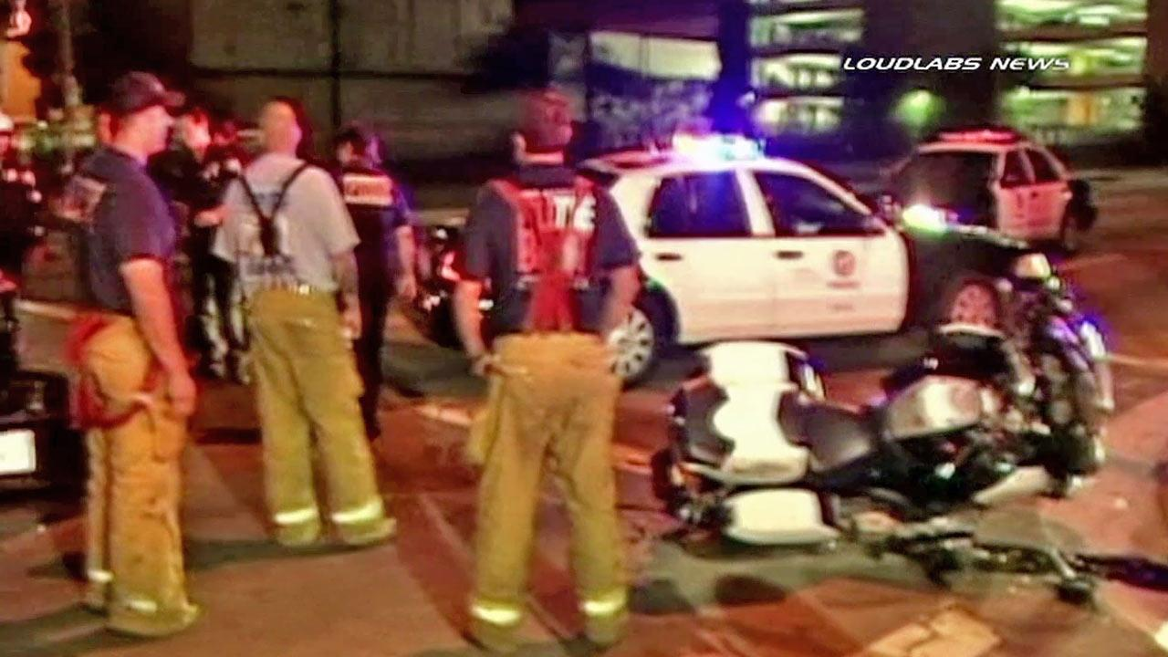 A late night crash in downtown Los Angeles sent an LAPD motorcycle officer to the hospital on Friday, Oct. 26, 2012.