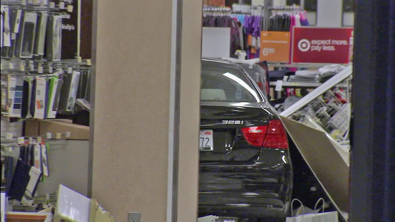 A BMW is seen after it plowed into a Target store in Canoga Park on Friday, Oct. 26, 2012.