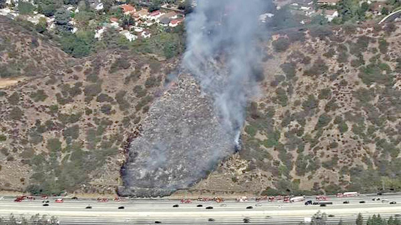Smoke from a fire is seen on a hillside off the 134 Freeway in Glendale on Tuesday, Oct. 30, 2012.