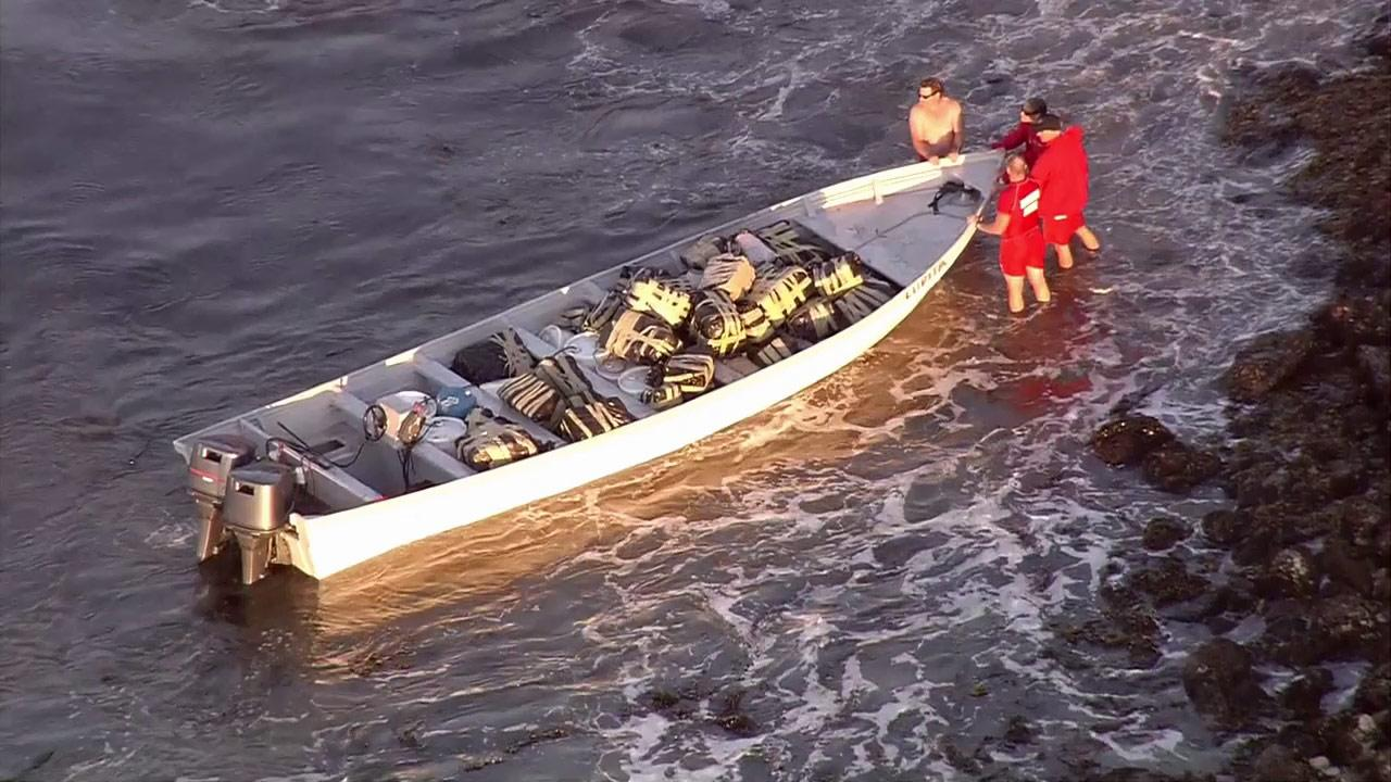 Three suspected smugglers were taken into custody after their boat ran aground off Malaga Cove in Palos Verdes Estatesin Palos Verdes Estates on Tuesday, Oct. 30, 2012.