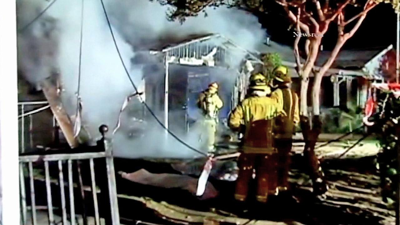 Firefighters are seen at a mens group home that burned down in Pasadena on Thursday, Nov. 1, 2012.