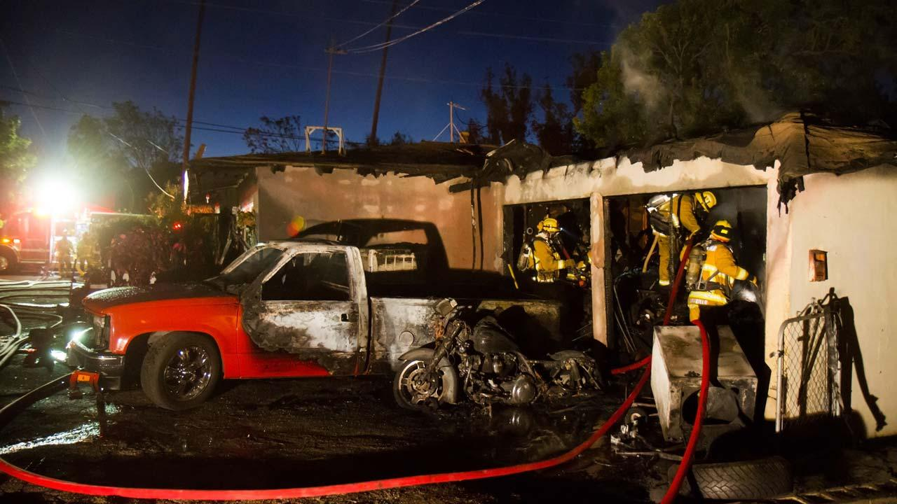 Several people are temporarily displaced after a fire swept through the garage of a home on the 300 block of Linda Rose Avenue in Pasadena Sunday, Nov. 11, 2012.