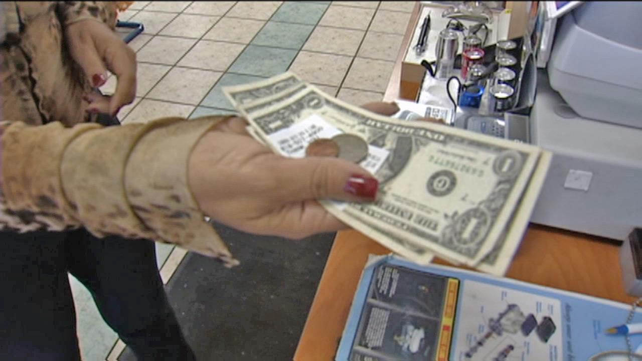 A store customer receives cash back at a Los Angeles business.