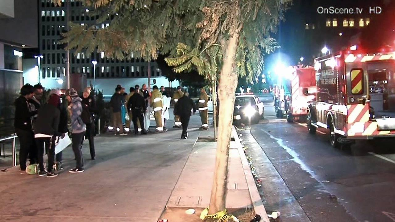 Police at the scene of a shooting outside a GameStop store at 3183 Wilshire Boulevard on Tuesday, Nov. 13, 2012.