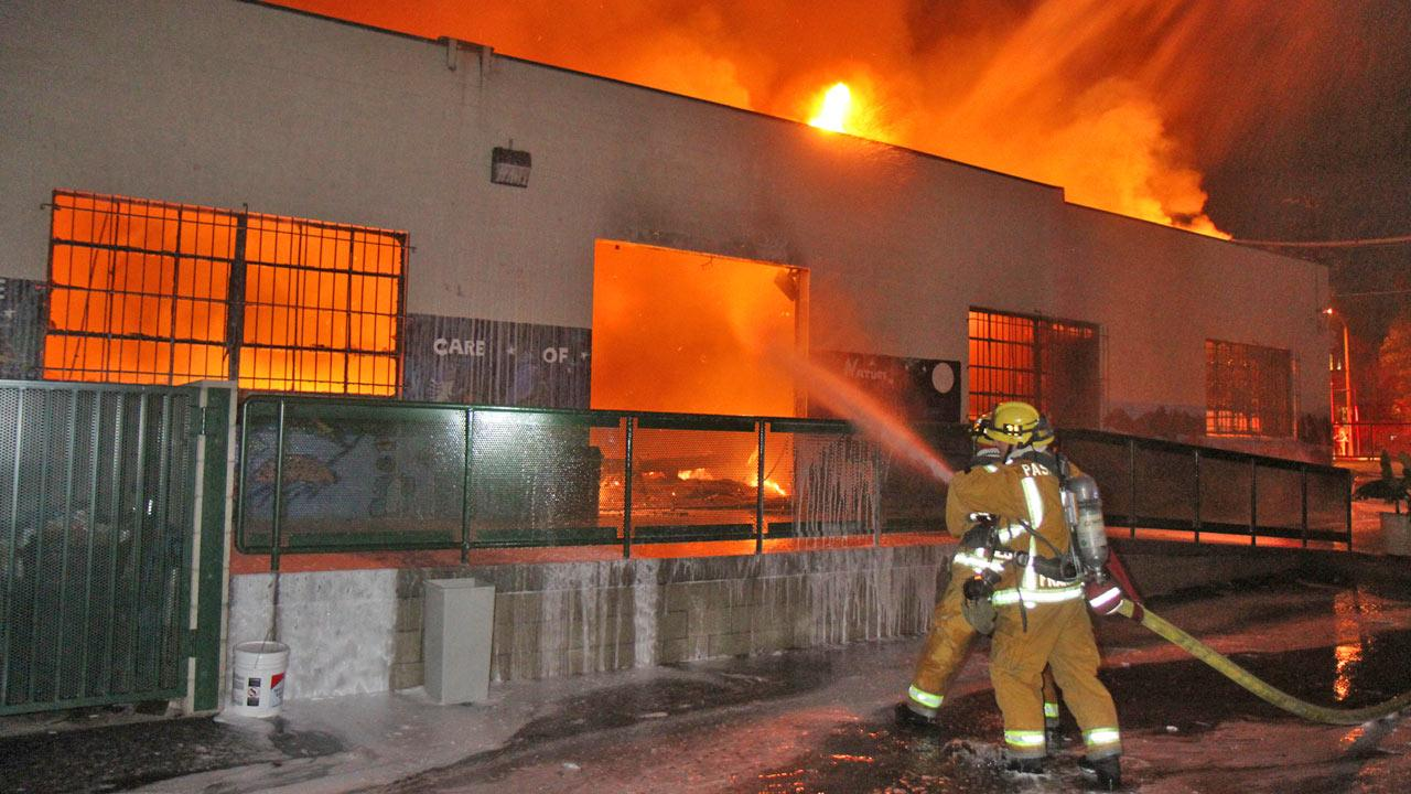 Firefighters work to put out a fire at the Opportunities for Learning charter school on the 400 block of West Montana Street in Pasadena on Saturday, Nov. 17, 2012.