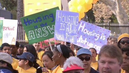 Tens of thousands of people participated in the 6th annual Homewalk to End Homelessness through the streets of downtown Los Angeles on Saturday, Nov. 17, 2012.