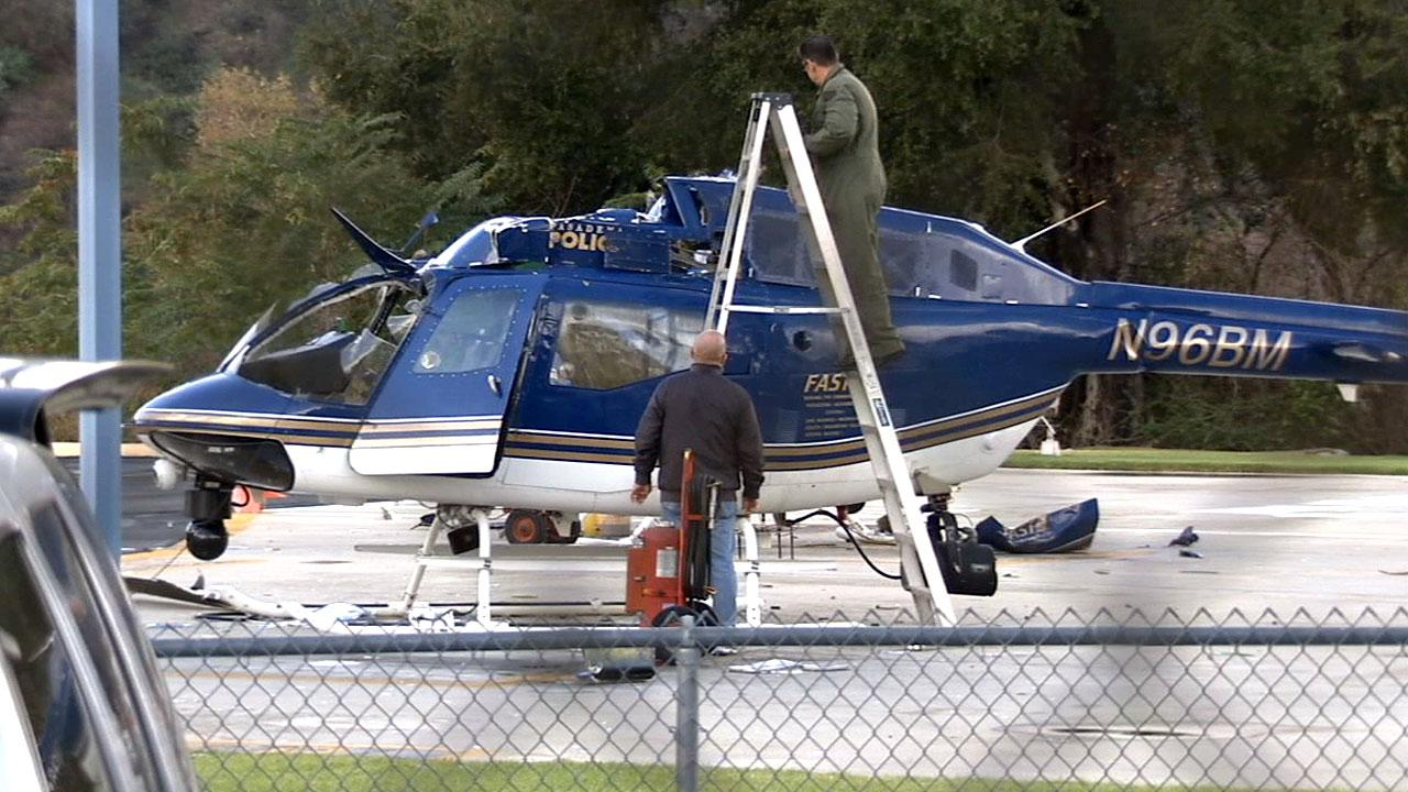 One of two Pasadena Police Department helicopters that collided is inspected on Sunday, Nov. 18, 2012.