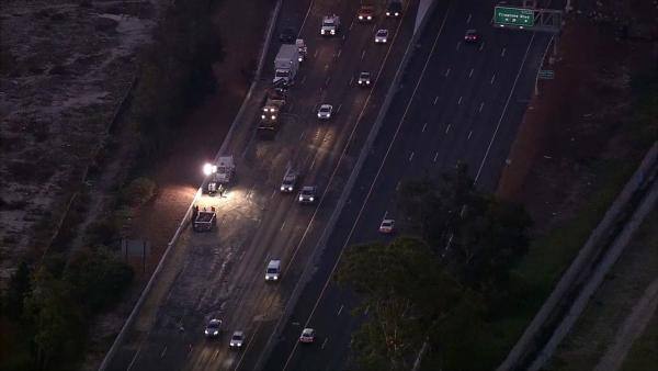 Big rig crashes, spills asphalt on 710 Freeway