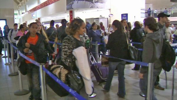 Holiday travelers heading home, pack LAX