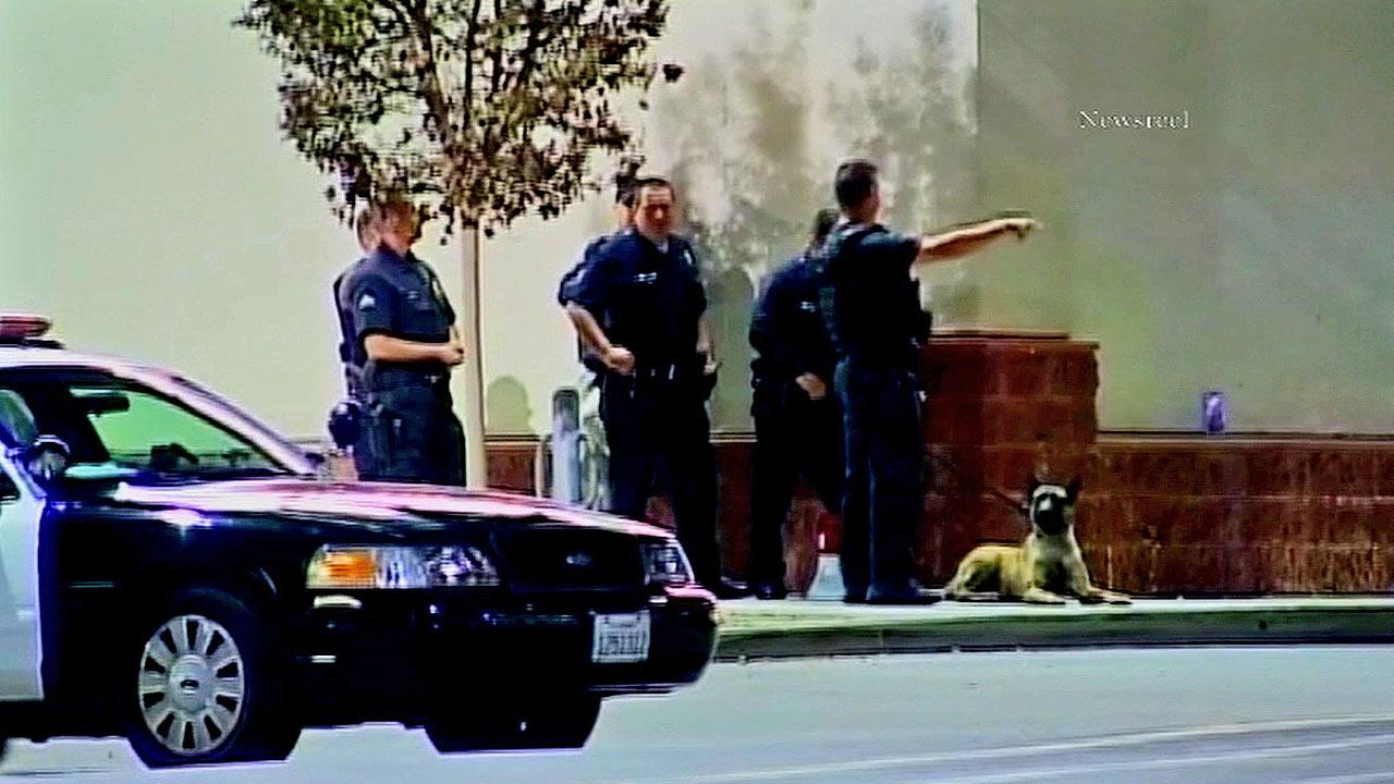 Police officers investigate the scene of an officer-involved shooting at the 99 Cents Only store on the 10900 block of Victory Boulevard in North Hollywood on Saturday, Nov. 24, 2012.