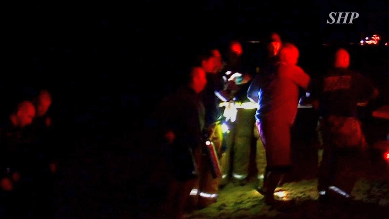 Emergency officials transport a woman on a stretcher off the Manhattan Beach Pier on Saturday, Nov. 24, 2012.