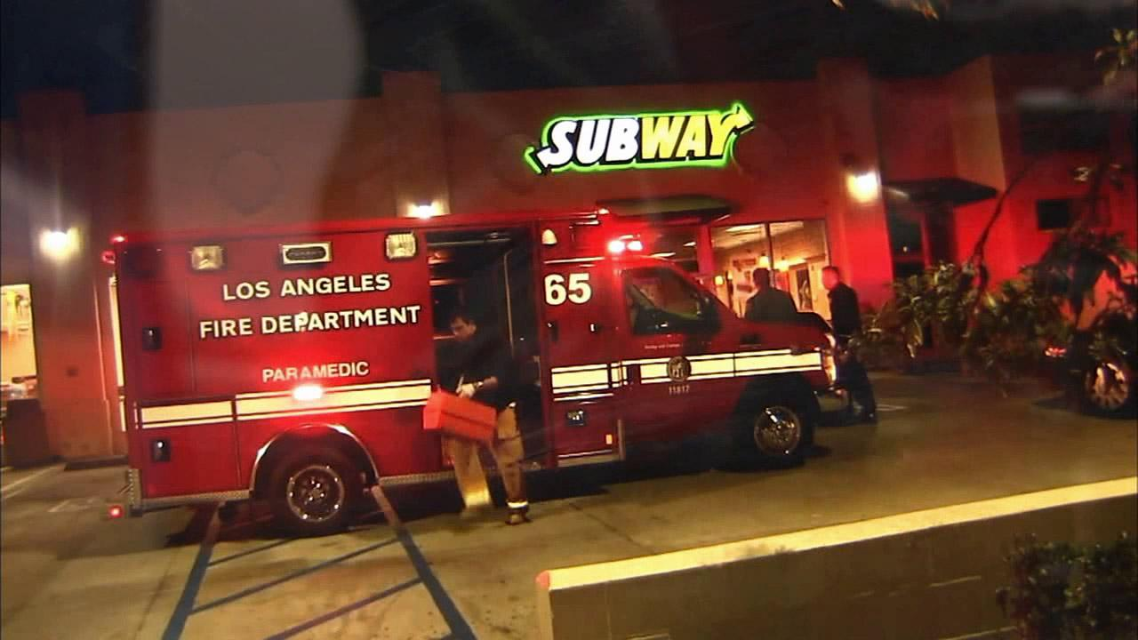 Los Angeles Fire Department first responders arrive at the scene of a robbery at a South Los Angeles Subway restaurant on Monday, Nov. 26, 2012.