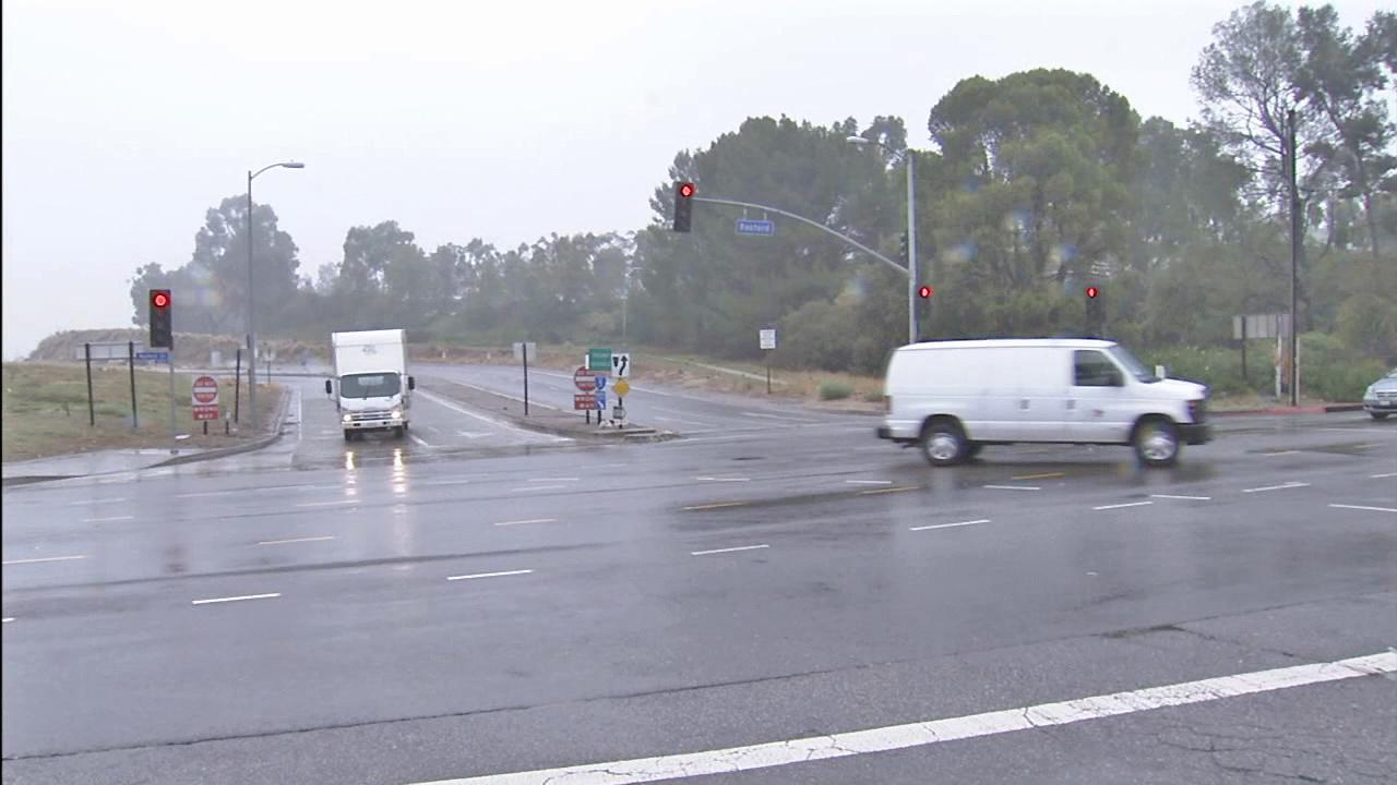 Drivers are seen in the rain in Sylmar in this photo from Thursday, Nov. 29, 2012.
