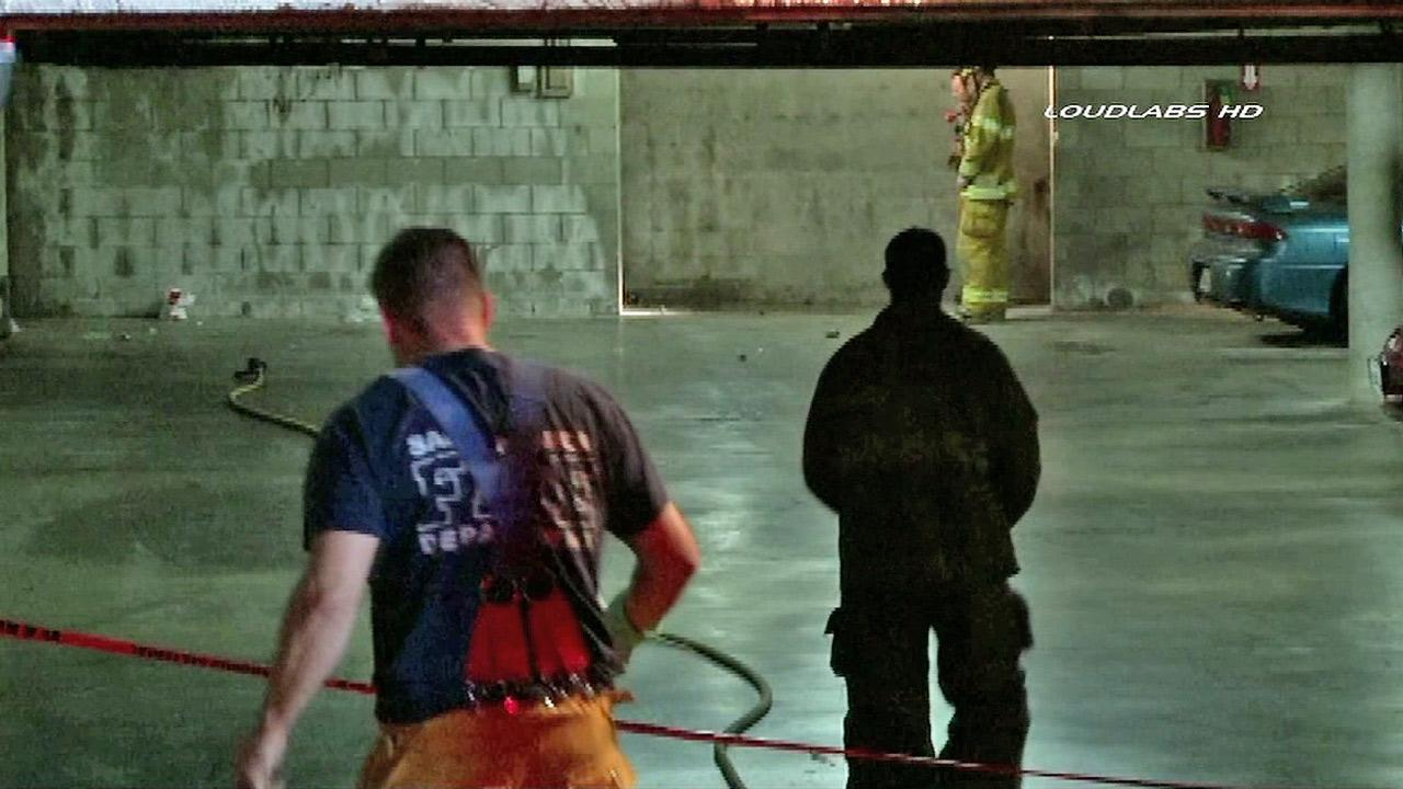 Firefighters are seen investigating an underground parking garage in Santa Monica where a homemade explosive device went off on Monday, Dec. 17, 2012. No one was injured in the explosion and no damage was caused.