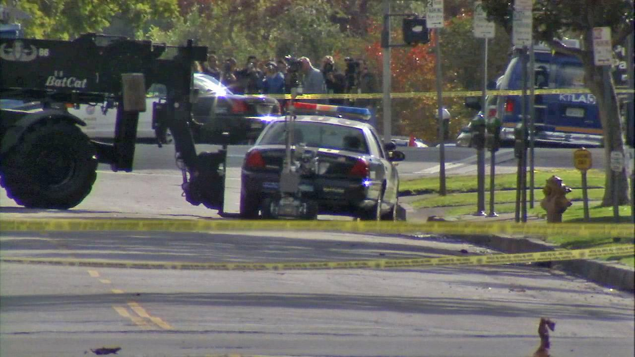 A Los Angeles police vehicle at the center of a suspicious package investigation is seen near Wilshire Boulevard Temple on Tuesday, Dec. 18, 2012.