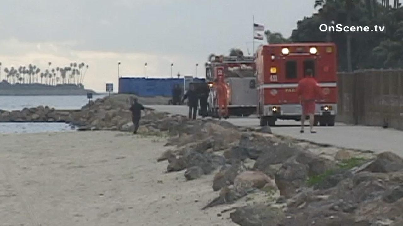 Firefighters are seen near the 600 block of Shoreline Drive in Long Beach. A man was found unresponsive near a jetty in the Long Beach Harbor Saturday, Dec. 29, 2012. He was later pronounced dead at a nearby hospital.