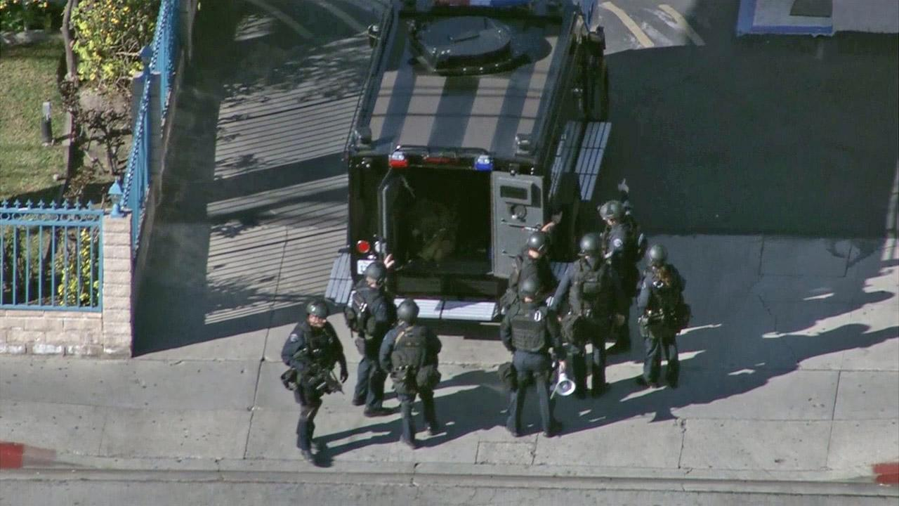 An LAPD SWAT team responds to a robbery suspect barricaded in a motel in North Hills on Friday, Jan. 4, 2013.