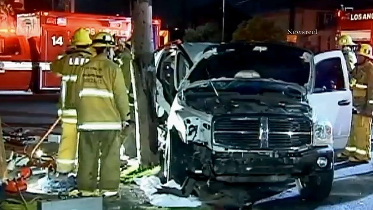 Firefighters respond to the site of a crash near Griffith Avenue and 22nd Street in Los Angeles after an alleged drunk driver slammed into a car carrying a family of three on Sunday, Jan. 6, 2013.