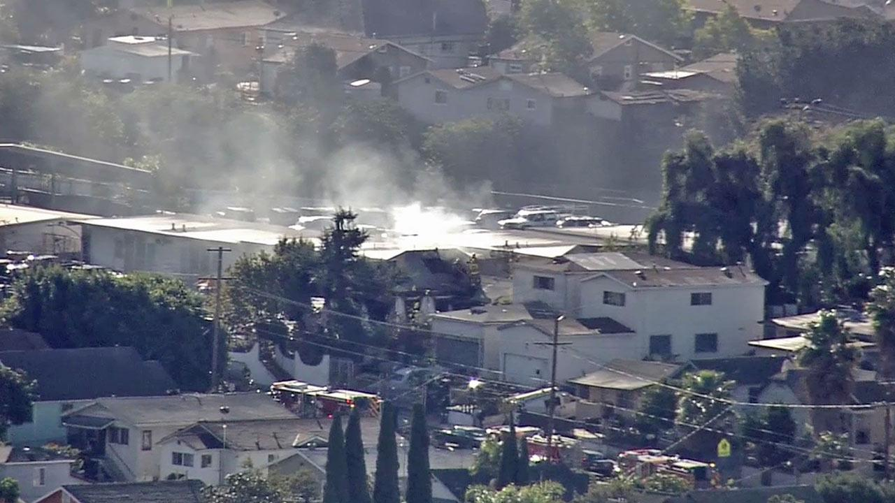 Smoke rises from the scene of a house fire in Boyle Heights on Thursday, Jan. 10, 2013.