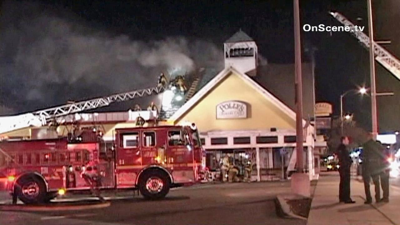 Firefighters battle a blaze at Pollys Pies Restaurant in Whittier on Thursday, Jan. 17, 2013.