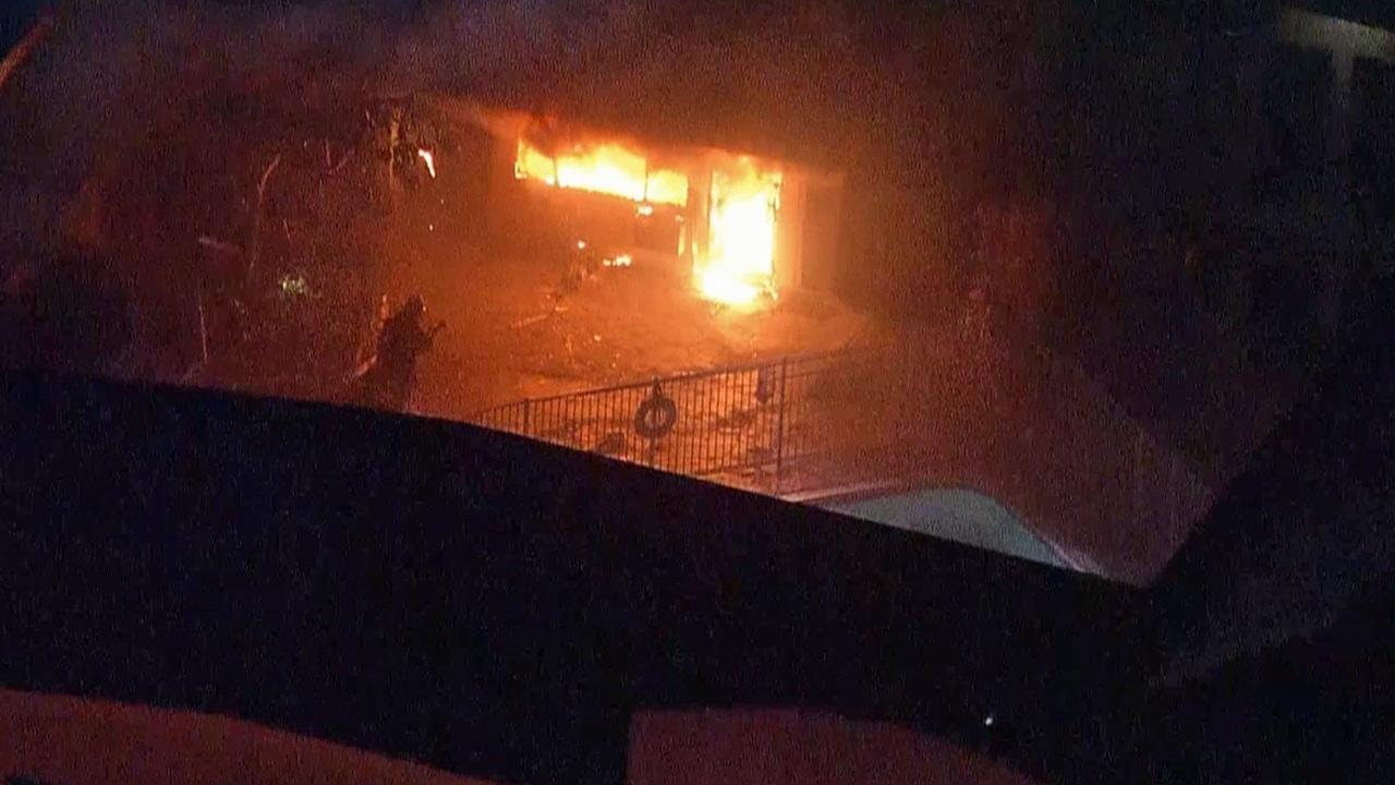 A building in an apartment complex in North Hollywood is shown on fire in this still image from AIR7 HD footage taken on Wednesday, Jan. 23, 2013.
