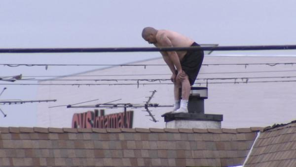 Shirtless man on LA roof refuses to come down