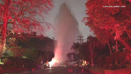 A car slammed into a fire hydrant in Beverly Hills, sending up hundreds of feet into the air on Benedict Canyon Road near Clear View Drive on Friday, Jan. 25, 2013.
