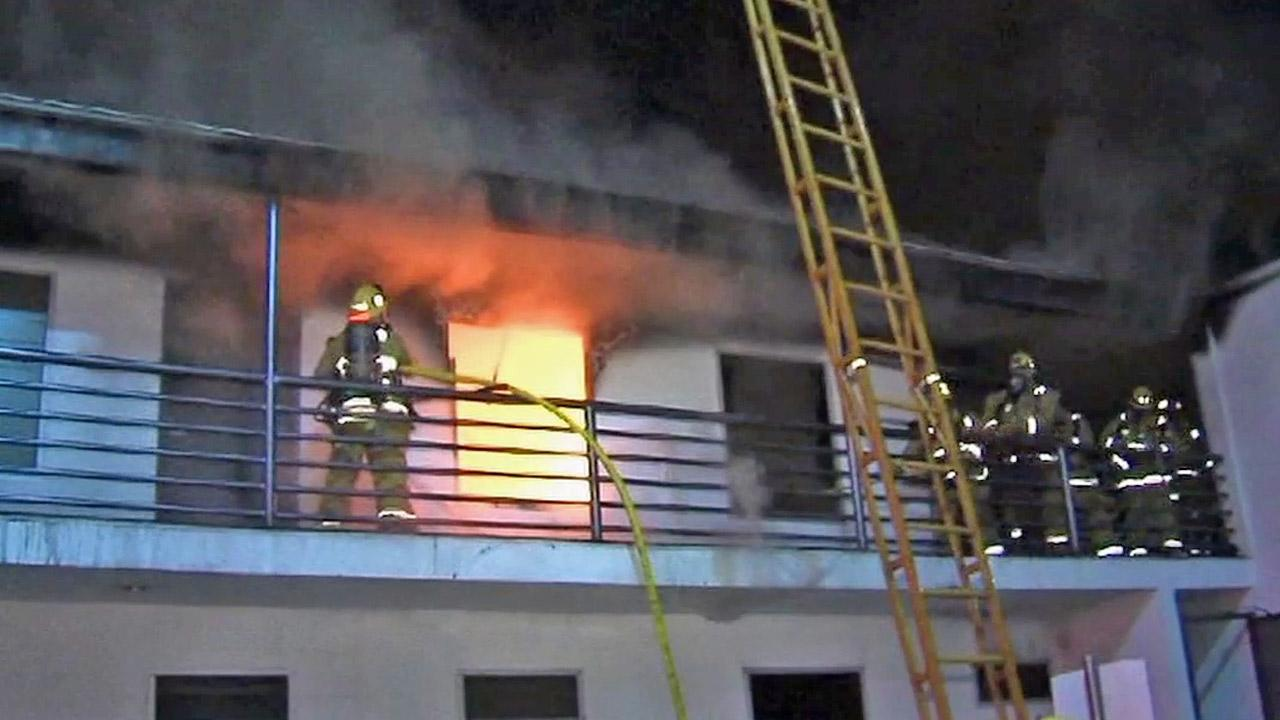 Firefighters battle a fire in an empty office space in the 1200 block of South La Cienega Boulevard in the South Carthay neighborhood of Los Angeles on Thursday, Jan. 31, 2013.
