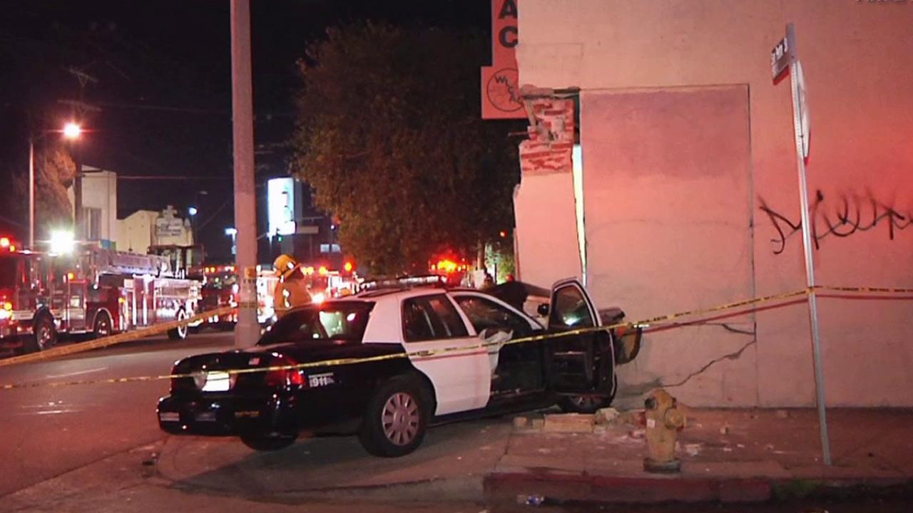 A police vehicle crashed into a building in South Los Angeles during a pursuit on Sunday, Feb. 3, 2012.